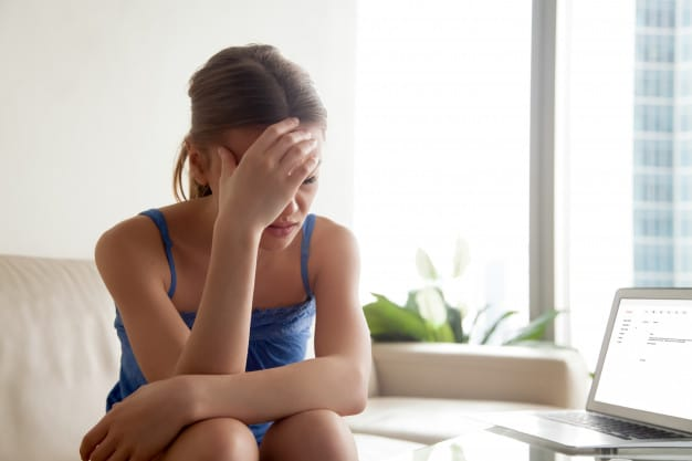 woman-upset-because-bad-news-e-mail-letter_1163-3864